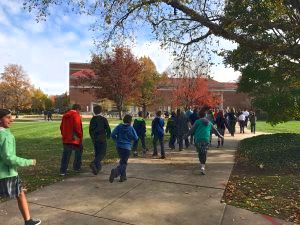 Student walking to ArcAttack Matinee at Purdue, November 2016