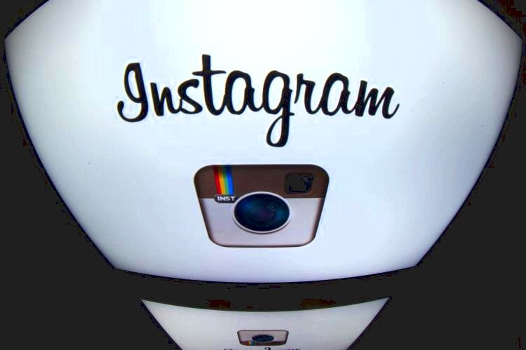 The Instagram logo is displayed on a tablet on December 20, 2012 in Paris. Instagram backed down on December 18, 2012 from a planned policy change that appeared to clear the way for the mobile photo sharing service to sell pictures without compensation, after users cried foul. Changes to the Instagram privacy policy and terms of service set to take effect January 16 had included wording that appeared to allow people